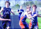Jared Josephson (right) handed the baton to Sean Dilley of Minneota during a relay race at Lakeview.