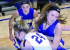 Natalee Rolbiecki grabbed for a rebound against Lakeview's Savanna Rausch as Abby Hennen looked on in the background.
