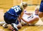 Abby Rost (right) battled RTR's Allie Christiansen for a loose ball.