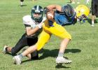 Minneota's Blake Reiss had the ball tucked in as he ran past a Pipestone defender during the scrimmage in Tracy last Saturday. The Vikings will return to Tracy Thursday night to open the season against the Tracy-Milroy-Balaton Panthers.