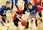 Two Minneota-Lincoln players battled for the ball with a Spring Grove player in the fifth-grade boys third-place game of the Pacesetter Minnesota Youth Basketball State Championships on Sunday in Maple Grove.