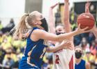 Abby Rost drives to the basket to score two of her nine points against Houston on Tuesday in Mankato.