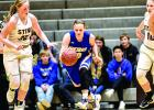 Lydia Sussner had three steals for the Vikings, and on this one she pushed the ball up the court against YME's Madison Hinz (left), Mackenzie Dyrdahl (30) and Anna McCosh (10).