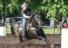 Tammy Blegen races around the barrels during competition on Wednesday, May 27 at the Minneota Arena.