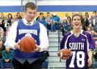 Reversing their roles were football all-star Tanner Differding, carrying a basketball and basketball player Beth Hennen with a football (left).