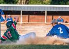 Tate Walerius, left, of the Mudhens slides safely into third base against Rosen last Friday night at Kompelien Field in Minneota.