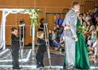 With the help of crutches holders, Tate and Blake Koons, Nelson and her date Jared Josephson posed for pictures in front of the crowd at the Minneota Prom on Saturday.