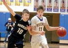 Minneota sophomore Thomas Hennen (11),  was guarded closely by Huskie Jacob Christopher.