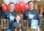 Coach Travis Christenson, Lincoln Christenson and Coach J.D. Pesch posed with their awards for the THOR Wrestling Club.