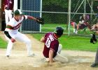 Pitcher Tommy Fischer tried to cover home to keep a run from scoring, but the throw was too late.