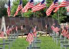 "Finally a reality. Minneota Veteran's Park, adorned with flags, memory crosses and the ""Pavers"" honoring area heroes, was dedicated Monday, Memorial Day."