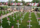 "Veterans Park in Minneota was a sea of red, white and blue with American flags on each of the 286 white crosses that represented deceased veterans from the area, and 34 gold crosses representing area soldiers who were killed in action. Despite the COVID-19 pandemic keeping a few people away, the Memorial Day ""Light a Light"" ceremony was well attended on a mild evening."