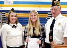 "Klaire Banks (center) won the ""Voice of Democracy"" essay contest and has been entered in the District competition. With her were VFW Commander Pam Gregor (left) and Ed Lozinski, who has been helping sponsor the event."