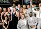 Anthony Harris of the Vikings, back, poses with Dan and Cindy Scamp and their wedding party.