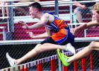 Carter Wente crosses the hurdle.
