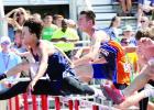 Carter Wente (center) ran the 110-meter hurdles at the state meet.