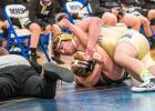 Jayden Gamrak of Minneota locks up Austin Sweep of County en route to pinning him in the first period recently.
