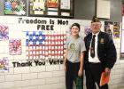 Faith Myhre, shown with Ed Lozinski, was the first place winner from St. Edward School.