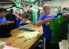 Helping sort clothes were: (left to right) Chloe Davis, Ava Larson and Cole Myhre.